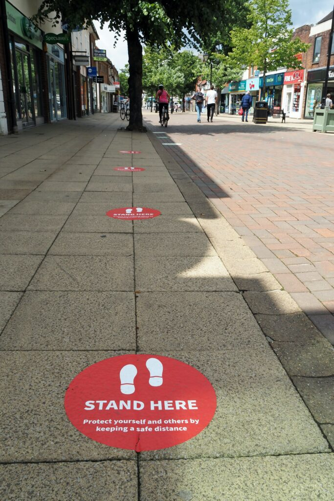 2 metre distance stand here sign